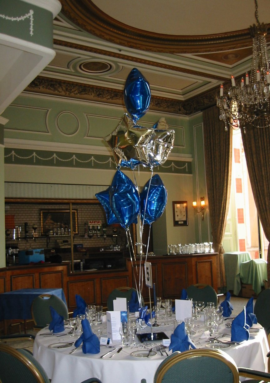 7 x Foil Balloons either shaped as Stars or Balloons dressed with matching metallic ribbon & heart or star weights.