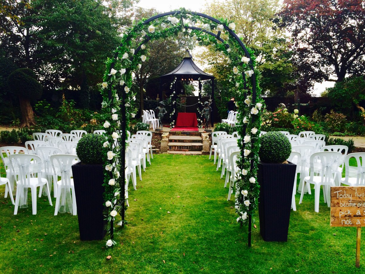 Blakelands own black arch & pagoda dressed with silk ivory & variegated ivy garlands + 60 x Sashes for outside chairs