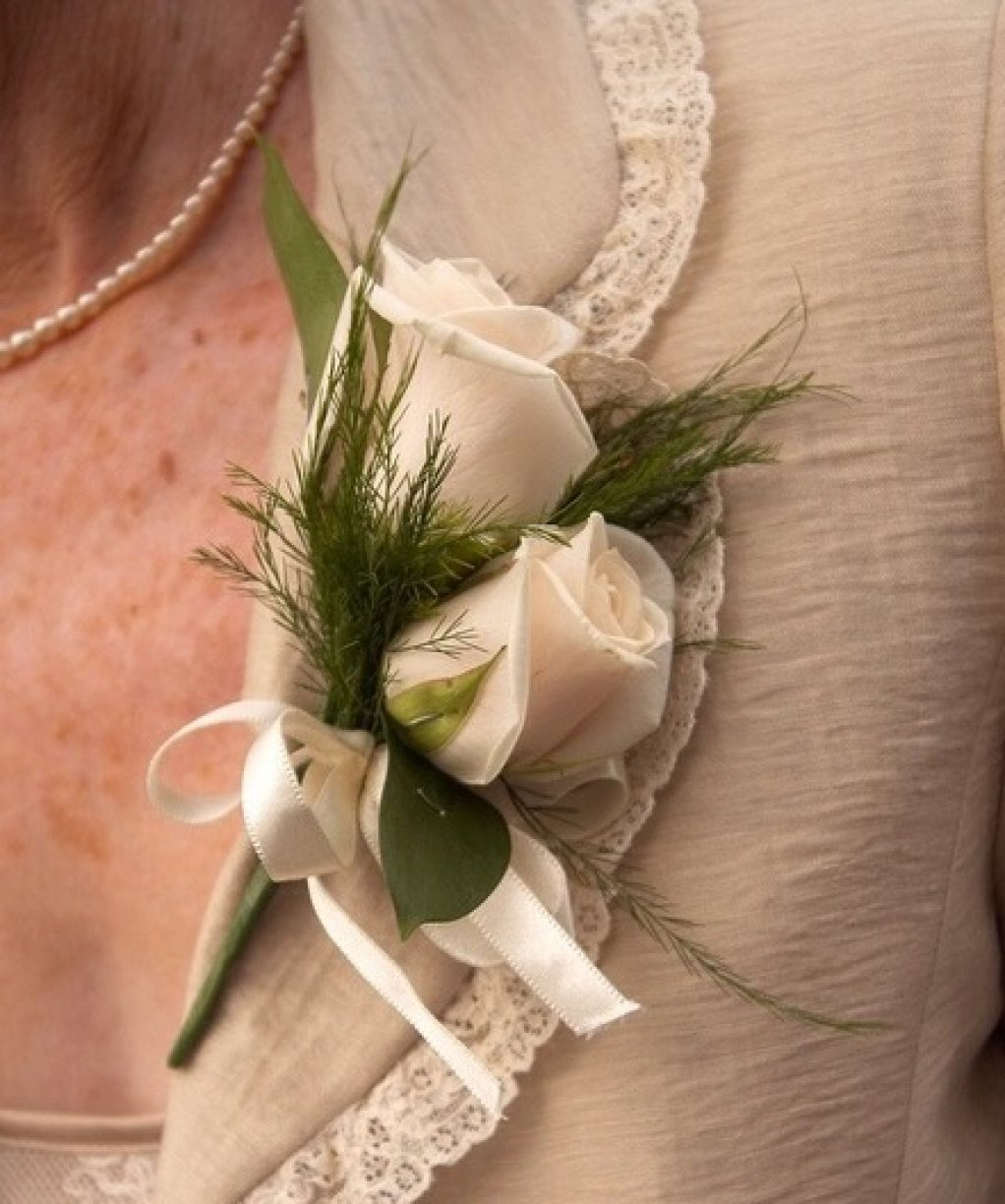 Usually for the Ladies being more decorative with foliage & added ribbon, beading or diamanté! Single or Double flowers