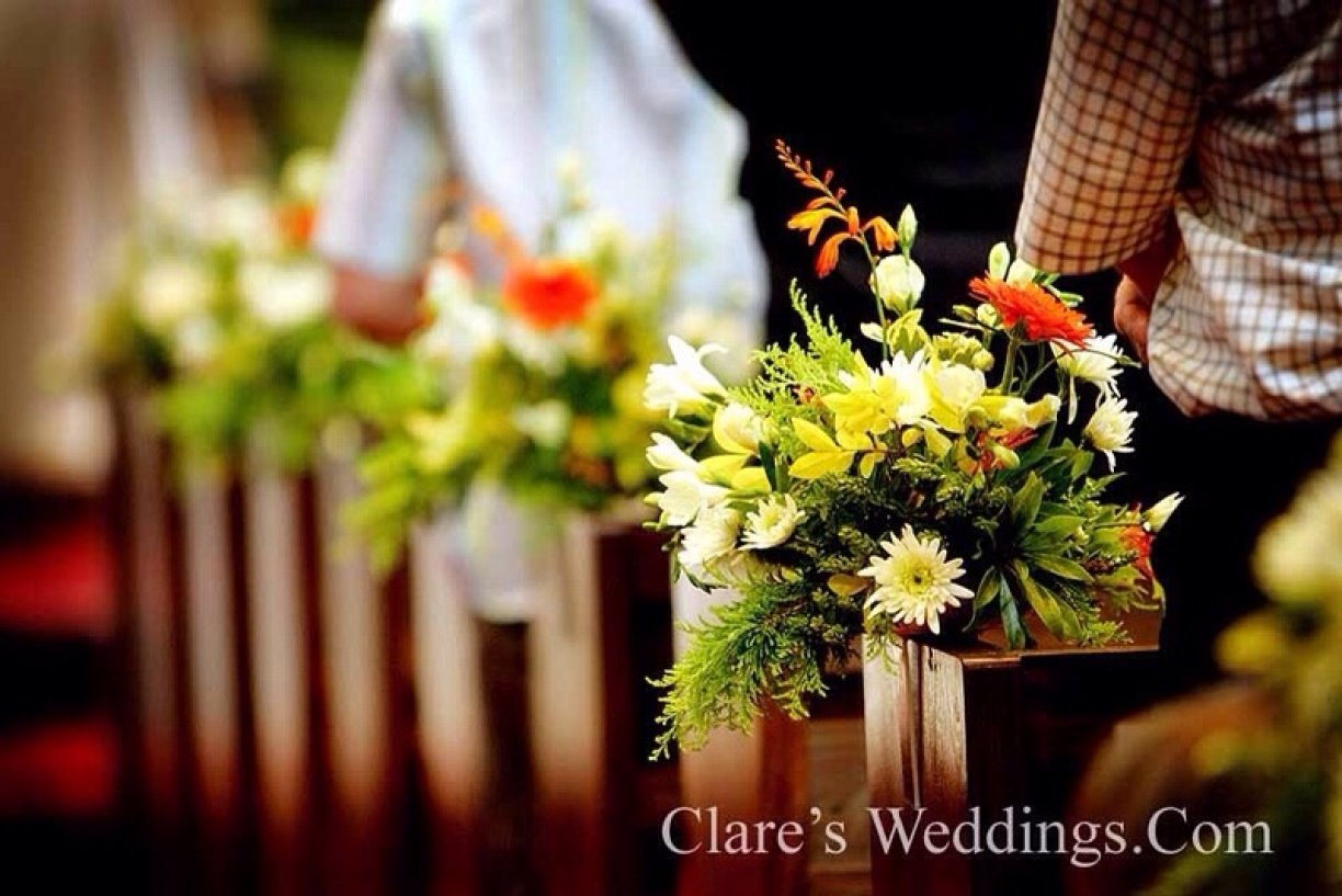 Altar Flowers, Pedestals, Garlands & much more available! Pew Flowers shown.