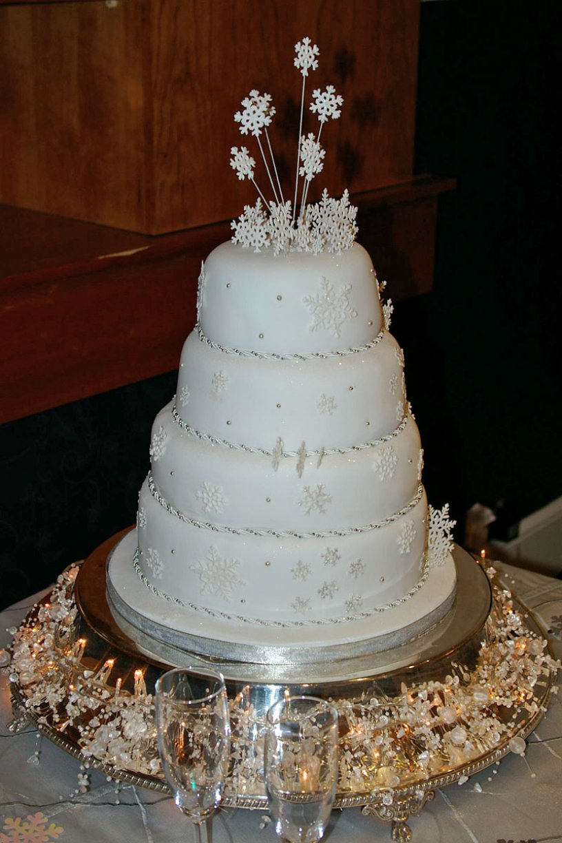 4 x Tier Cake dressed with Snow flakes & Silver Pearls.