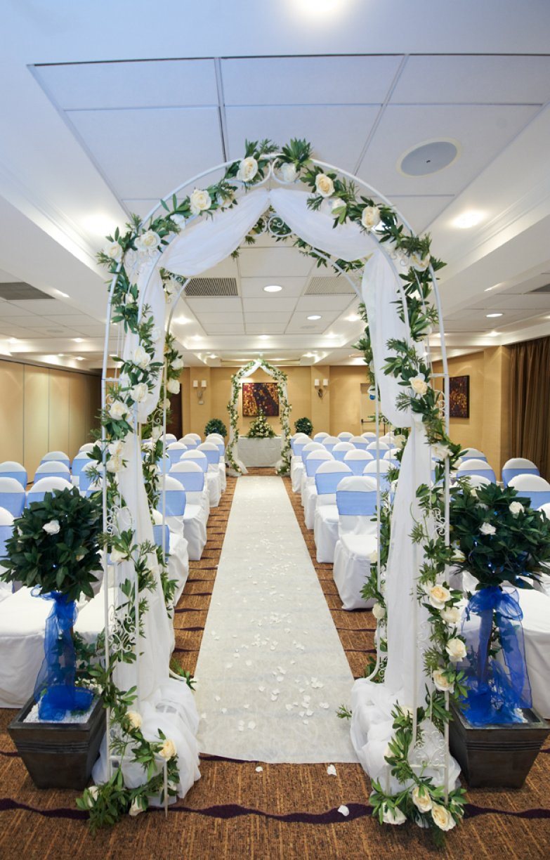2 x Arches dressed with Ivory Organza, Ivory Roses & Variegated Ivy Garlands.	4 x Bay Trees + Fairy Lights	1 x Isle Runner dressed Silk Rose Petals	 Civil Arch Packages