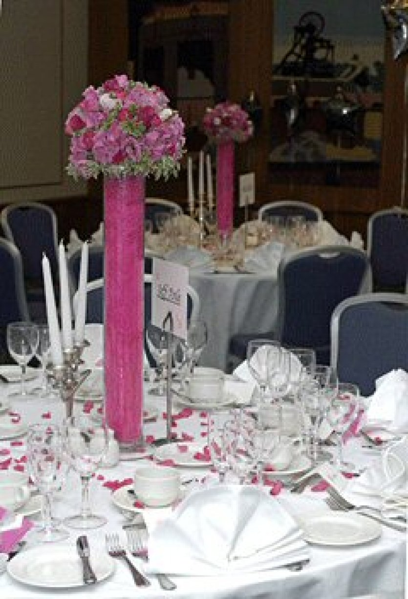 Hydrangea, Lizianthus & Milano Cerise Roses dressed with Hot Pink Sisal.